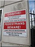J0407 : Bi-lingual Pedestrian Notice at Dundalk Bus Station by Eric Jones