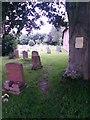 SZ0696 : Kinson: footpath E26 follows the edge of the churchyard by Chris Downer