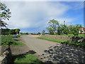 NO5114 : The road past Allanhill Farm Shop by Bill Kasman