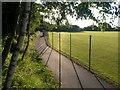SZ0793 : Ensbury Park: footpath N08 alongside school fields by Chris Downer