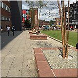 SP3379 : Walking and sitting in remodelled Trinity Street, Coventry by Robin Stott