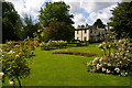 TQ2668 : Morden Hall Park: mill buildings across the rose garden by Christopher Hilton