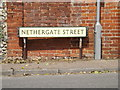 TL9979 : Nethergate Street sign by Adrian Cable