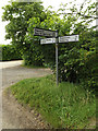 TM0076 : Roadsign on High Street by Adrian Cable