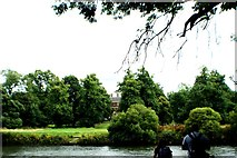 TQ1773 : View of Ham House peeping through the trees from the Thames by Marble Hill Park by Robert Lamb