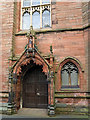 NY4055 : Door, Our Lady and St Joseph's Church by Rose and Trev Clough