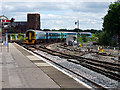SJ4912 : A train from the Cambrian line approaches Shrewsbury Station by John Lucas