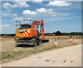 TG1815 : Digger south of Bell Farm by Evelyn Simak