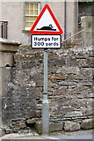 HU4741 : Snail on a roadsign, Commercial Street, Lerwick by Mike Pennington
