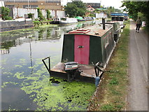 TQ2282 : Soft Asylum, narrow powered boat on Paddington Branch canal by David Hawgood
