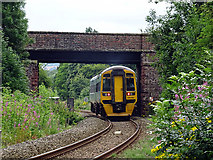 SJ4810 : An Aberystwyth bound train passes the site of Meole Brace station by John Lucas