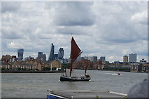 TQ3680 : View of a Thames Barge passing Canary Riverside by Robert Lamb