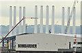 J3677 : Wind turbine masts, Belfast harbour - August 2016(1) by Albert Bridge