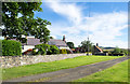 NU0028 : Houses at Way to Wooler by Trevor Littlewood