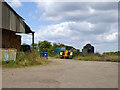 TL5358 : Yard at Frog End Farm by Robin Webster