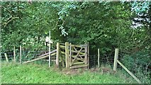 SK7259 : Gate and footbridge by Mather Wood by Chris Morgan