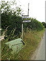 TL9874 : Roadsign & Grit Bin on The Street by Adrian Cable