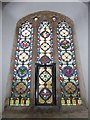 TM2894 : All Saints, Woodton: stained glass window (c) by Basher Eyre
