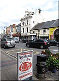 J0407 : Shops in Clanbrassil Street, Dundalk by Eric Jones