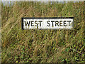 TM0274 : West Street sign by Adrian Cable