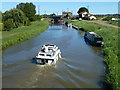 TF5801 : Boat approaching the lock at Salters Lode by Richard Humphrey