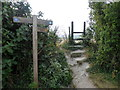 TQ5303 : Sign and Stile at Junction of Footpath and South Downs Way by PAUL FARMER