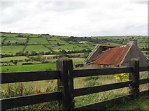 J2226 : Dilapidated tin roofed cottage overlooking the Leitrim Valley by Eric Jones