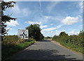 TL9470 : C645 Walsham Road & Roadsign by Adrian Cable