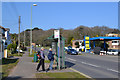 SX9777 : Walkers looking up bus times, Exeter Road, Dawlish by Robin Stott
