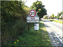 TM0890 : New Buckenham Village Name sign by Adrian Cable
