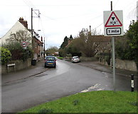 ST6976 : Warning sign - low bridge 1 mile ahead, Parkfield Road, Pucklechurch by Jaggery