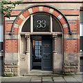 SK5739 : The doorway of Watson Fothergill's Milbie House by John Sutton