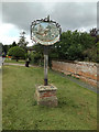 TL9076 : Fakenham Magna Village sign by Adrian Cable