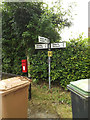 TL9769 : Stock Hill Postbox & Roadsign by Adrian Cable
