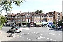 TQ1979 : Shops on the corner by Andrew Abbott