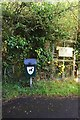 SP2705 : Dog waste bin and sign, near Carterton, Oxon by P L Chadwick