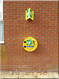 TM1686 : Defibrillator on Tivetshall Village Hall by Adrian Cable