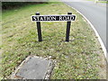 TM1886 : Station Road sign by Adrian Cable