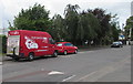 SO9322 : Red van and red car, Alstone Lane, Cheltenham by Jaggery