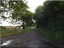 TM1888 : Entrance to Walk Farm & Carpenter's Walk Bridleway by Adrian Cable