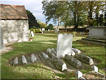 TQ7575 : 'Pip's graves' in Cooling Churchyard by Marathon