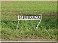 TM0994 : Mile Road sign by Adrian Cable