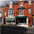 SH5800 : Walkers and Flame Lily in High Street, Tywyn by Jaggery