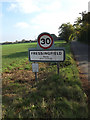 TM2577 : Fressingfield Village Name sign on New Street by Adrian Cable