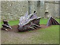 SN4007 : A Dragon at Kidwelly Castle by Derek Voller