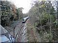 TQ5288 : Train approaching the bridge in Heath Park Road by Phil Gaskin