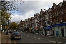 TQ2587 : North End Road, NW11, climbing away from Golders Green station by Christopher Hilton