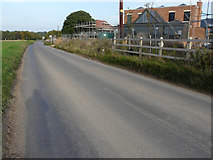TR2955 : Looking northeast along an unnamed road by John Baker
