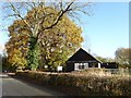 SO8742 : Trees beside Earl's Croome village hall by Philip Halling