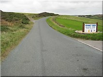 SS1900 : Road passing entrance to Penhalt Farm Holiday Park by Philip Halling